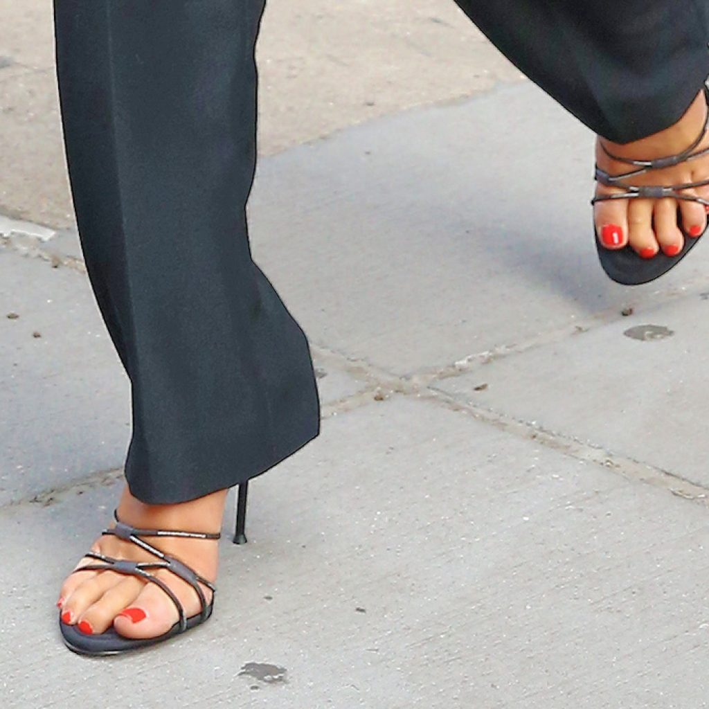 A closer view of Dua Lipa's strappy heels